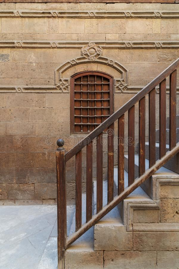 Wooden window and staircase with wooden balustrade leading to historic building, Old Cairo, Egypt. Wooden window and staircase with wooden balustrade leading to royalty free stock images