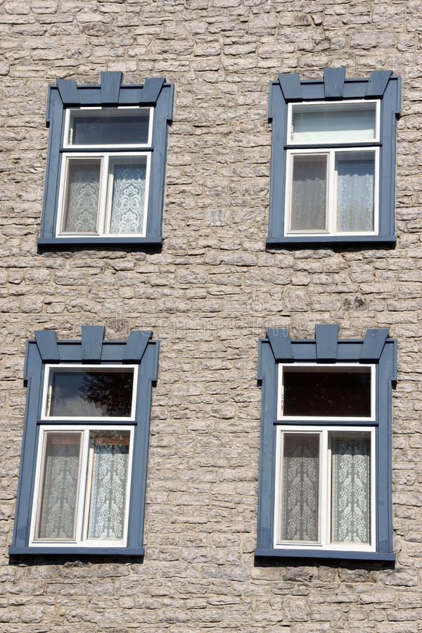 Wooden windows over an old building in Quebec. Grey wooden windows over an old stone building in downtown Quebec City. Quebec, Canada stock image