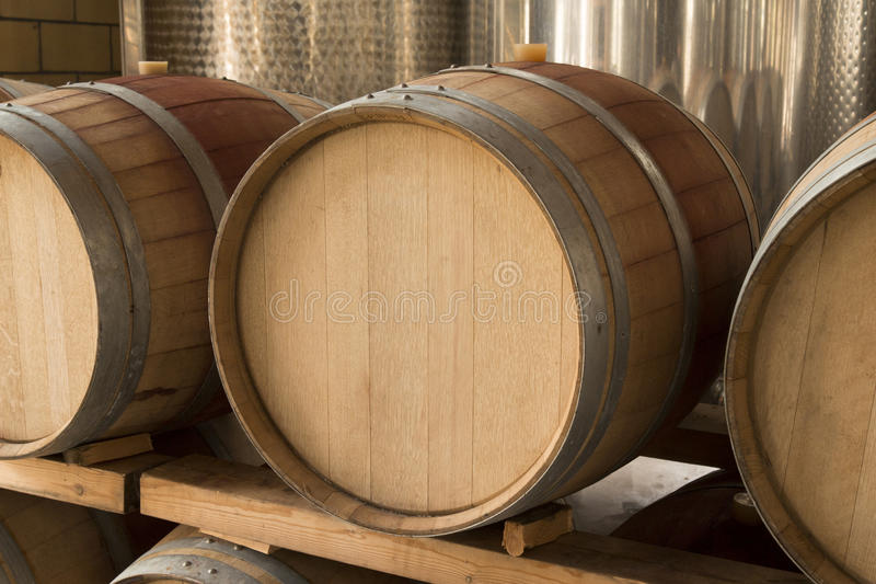 Wooden wine barrel. Close up of wooden wine barrel in wine cellar stock images