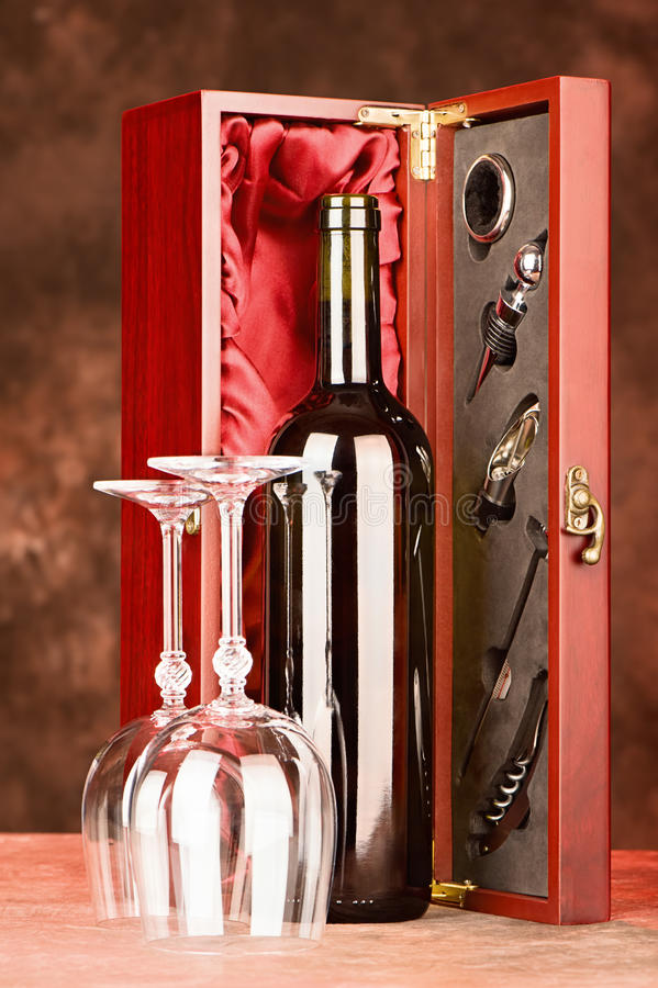 Wooden wine case with wine and glasses royalty free stock images