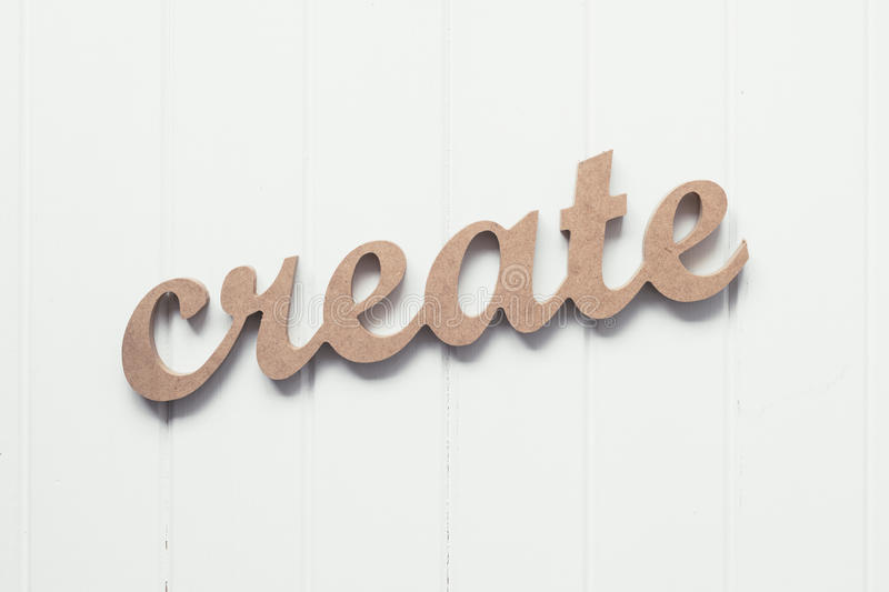 Wooden Word Create Against A Blue Background Stock Image