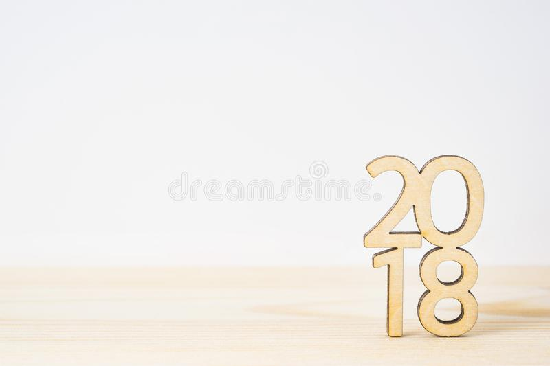 Wooden word 2018 on table and white background stock image