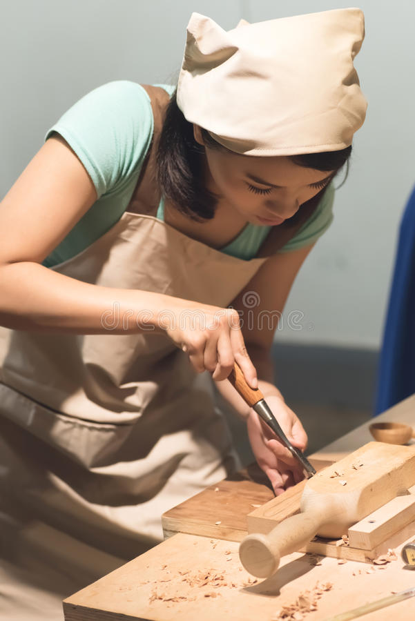 Wooden working. Woman carpentry at home, wooden work concept stock images