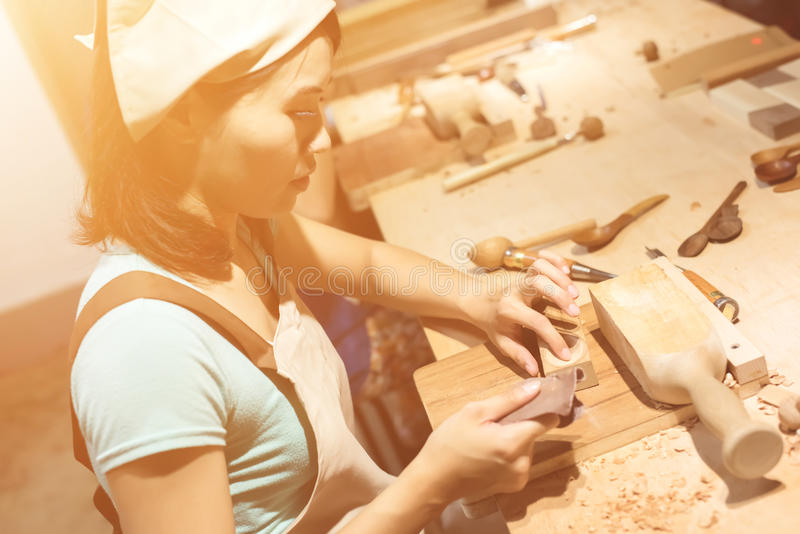Wooden working. Woman carpentry at home, wooden work concept stock photo