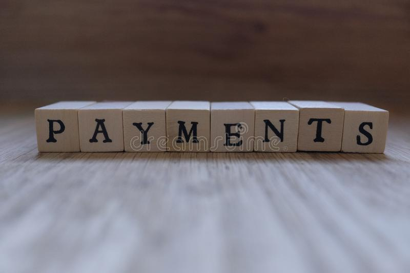 Wooden writing payments. On table royalty free stock photos