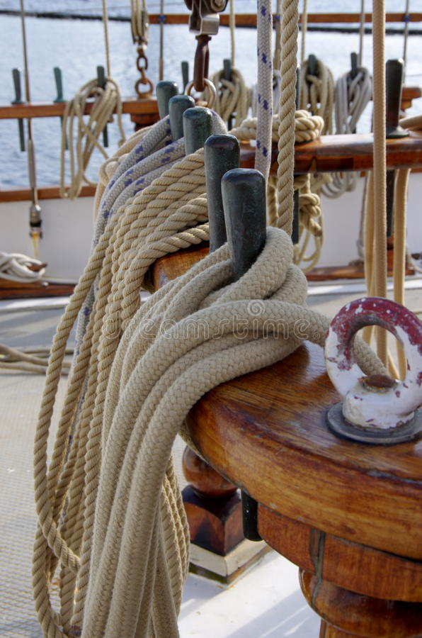 Wooden yacht element. Sea ropes and knots on a wooden ship stock photos