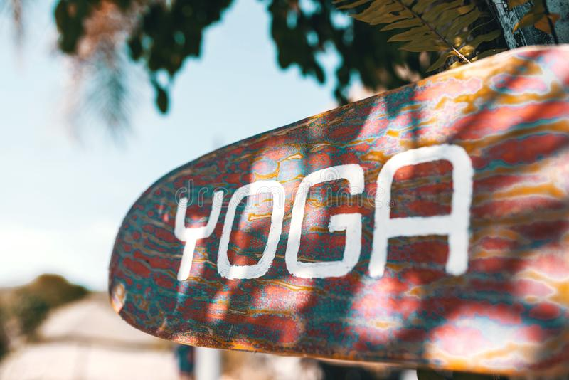 Wooden yoga sign stock photo