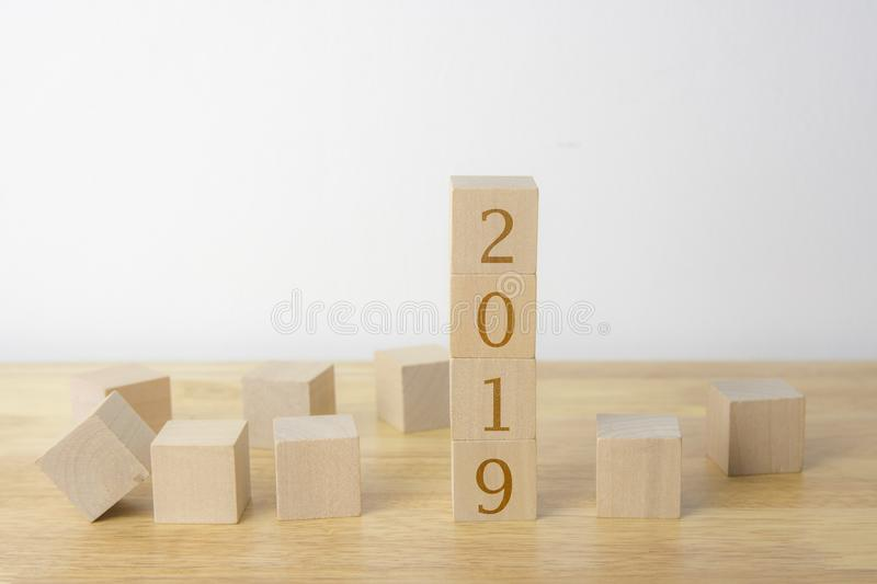 Woodens cubes on table and cement wall royalty free stock photo