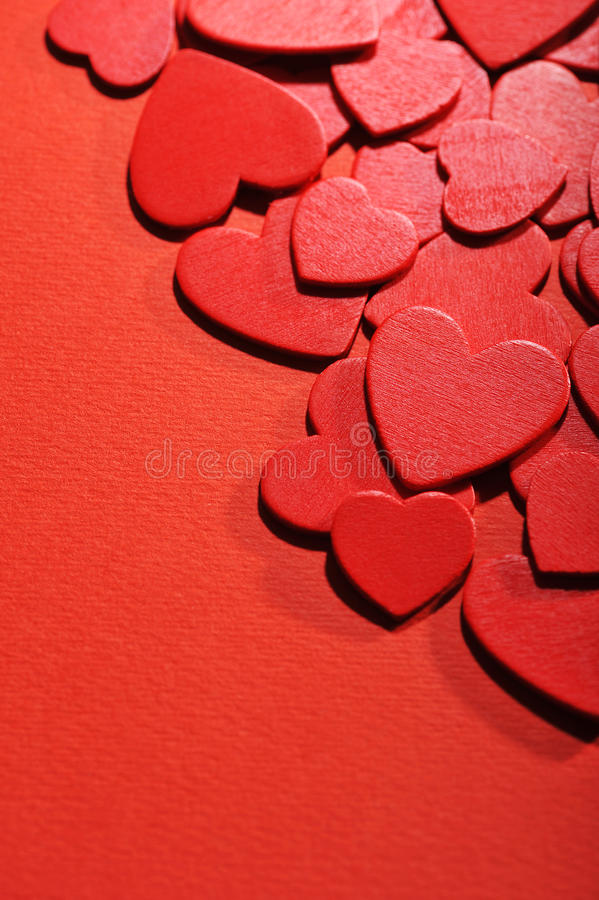 Woodhearts. Many small red wood hearts on red background stock images