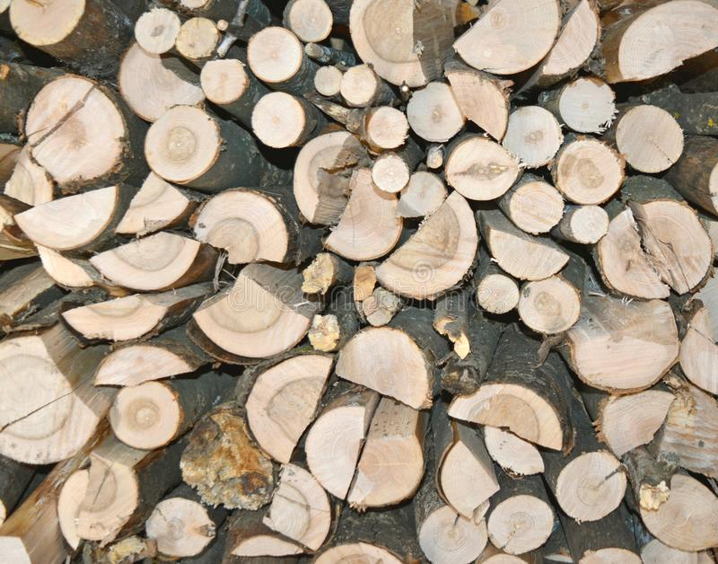 Woodpile end of tightly packed chopped logs royalty free stock photos