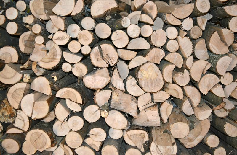 Woodpile end of tightly packed chopped logs stock photography