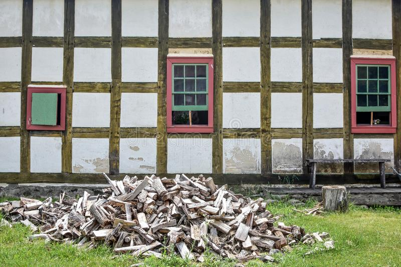 Woodpile in Front of German House stock images
