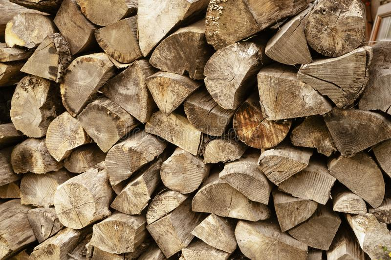 Woodpile of raw timber ready for winter season,Stack of firewoods,Pile of wood logs from forest, stock images