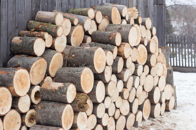 Woodpile of sawn spruce logs. Firewood for heating the house in winter.  stock image