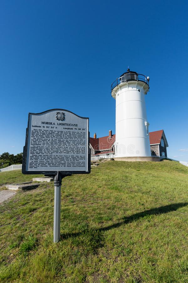 Nobska Lighthouse on Cape Cod with a descriptive sign. Woods Hole, MA - June 14 2019: Nobska Lighthouse with a descriptive sign telling the history of the light royalty free stock images