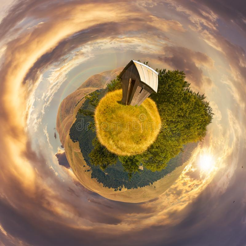 Woodshed on little planet spherical panorama stock photography