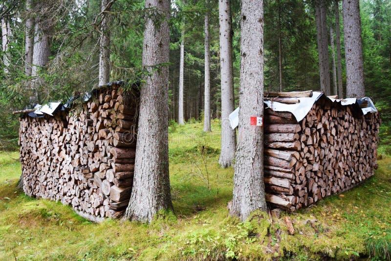 Woodsheds in Dolomiti mountains, Italy royalty free stock photo