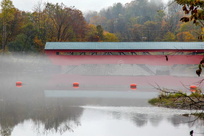 Covered bridge from Woodstock in fog royalty free stock photography