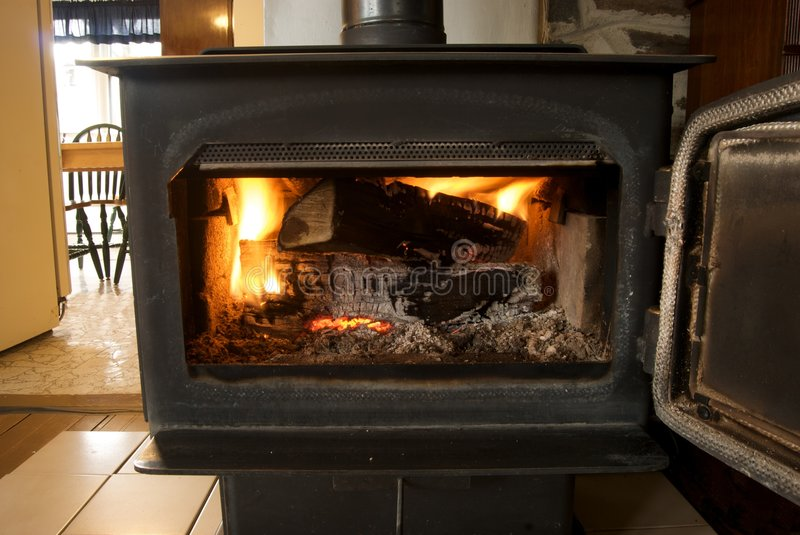 Woodstove Fire. Active Fire In A Wood Burning Stove Inside A Country Home stock photos