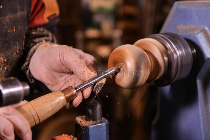 Woodturners using a rotating clamp to turn the wood. Woodturners using a rotating clamp to turn the wood, France royalty free stock photos