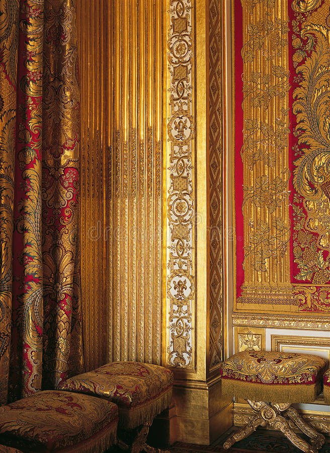 Woodwork and silks at Versailles Palace France. Woodwork and woven silks from Lyon in Louis XIVs room at Versailles Palace royalty free stock image