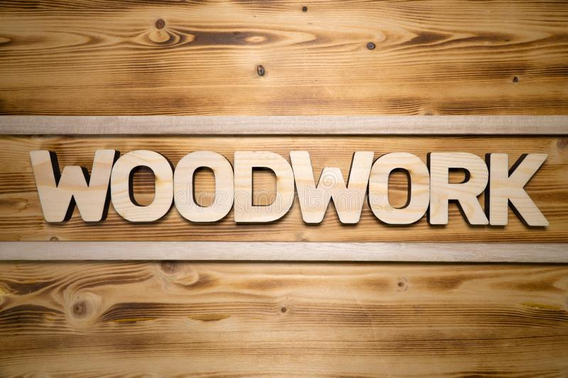 WOODWORK word made with building blocks on wooden board royalty free stock image
