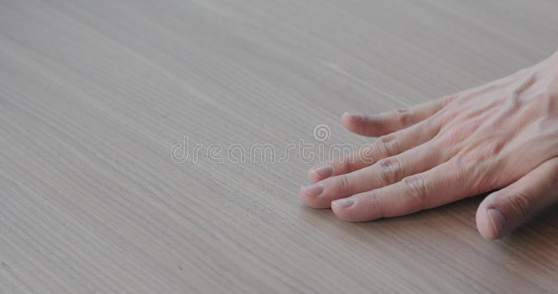 Woodworker checking black walnut surface royalty free stock photos