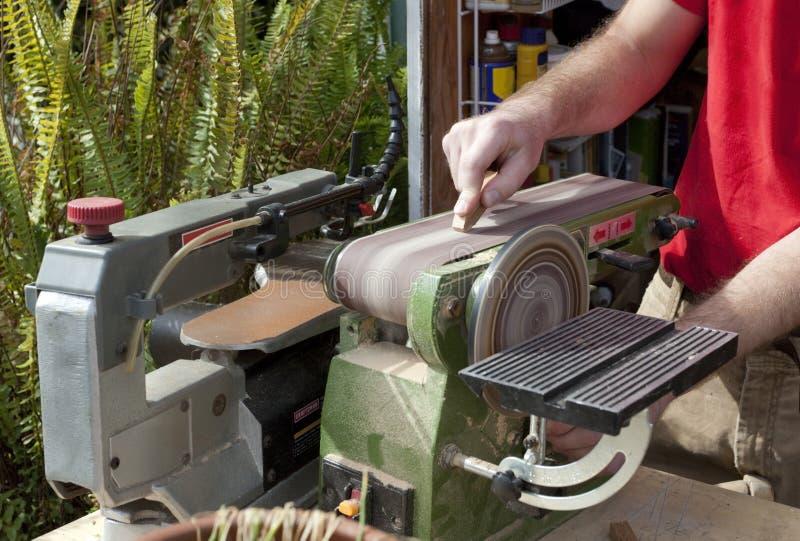 Woodworker sand belt sander. stock photography