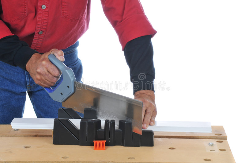Download Woodworker With Saw And Miter Box Stock Photo - Image: 7498632