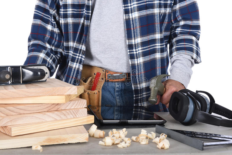 Woodworker Standing Behind Work Bench stock photo