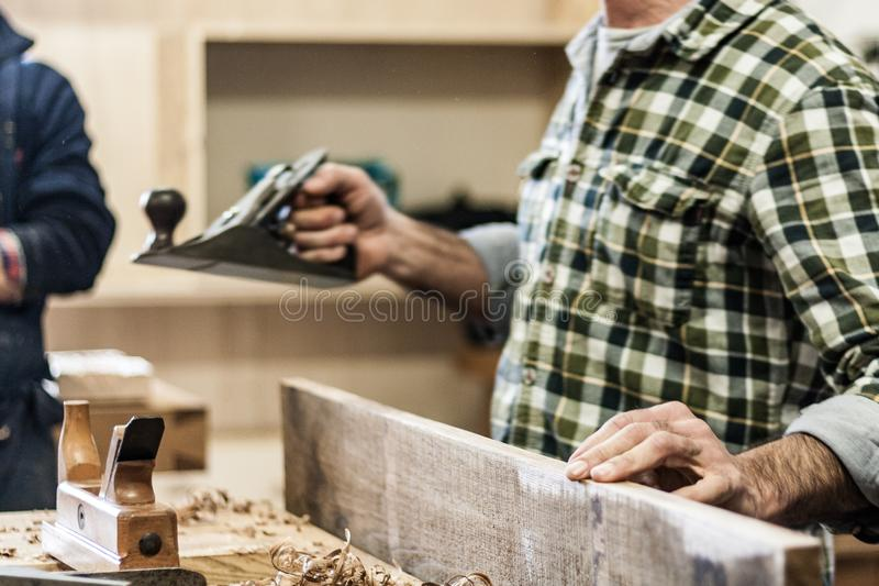 Woodworking art, an honest occupation within a sustainable lifestyle. Carpentry and cutting. stock photos
