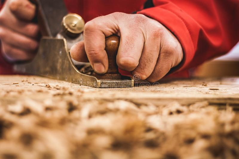 Woodworking art, an honest occupation within a sustainable lifestyle. Carpentry and cutting. royalty free stock photos
