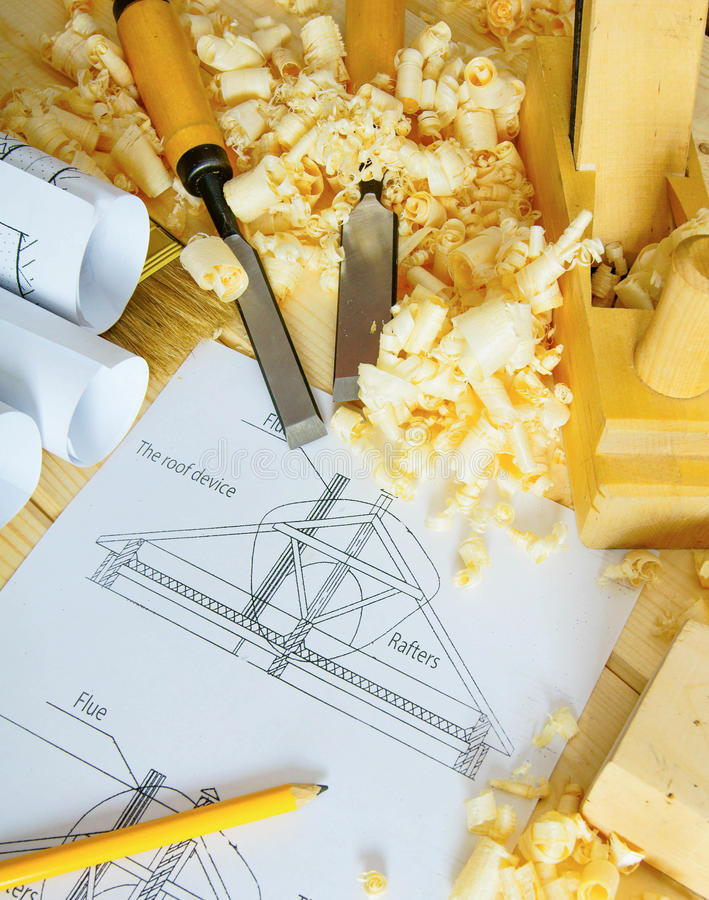 Woodworking. Drawings for building and working. Planning of repair of the house. Woodworking. Drawings for building and working tools on wooden background stock image