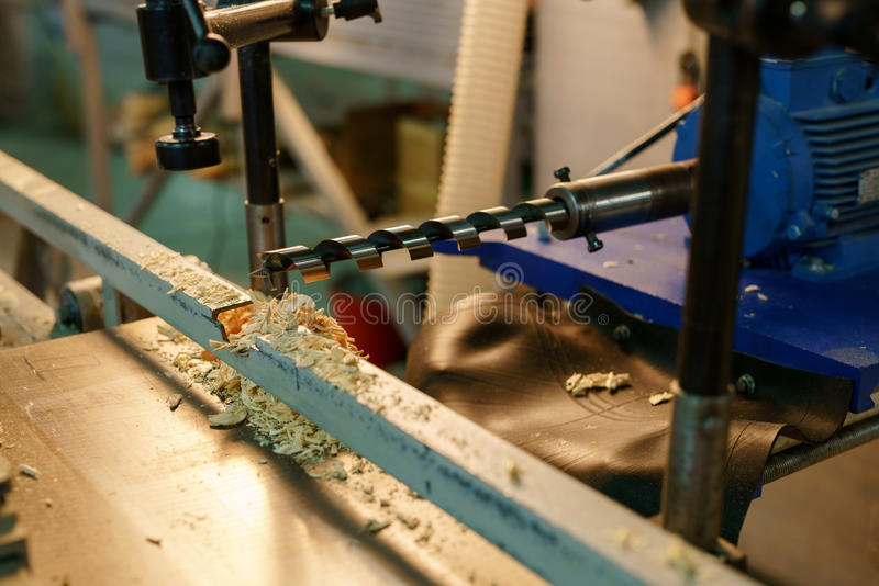 Woodworking. Image of drill machine, close-up royalty free stock photo