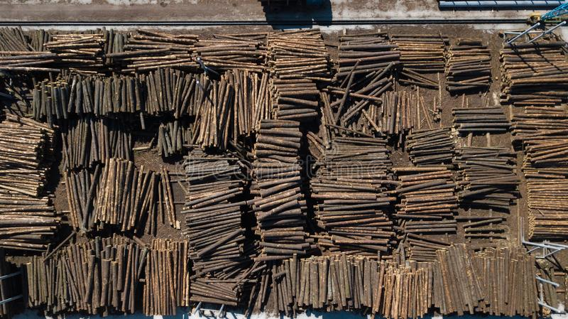 Woodworking industry. Raw materials for woodworking. Logs in stacks aerial photography with a drone royalty free stock photography