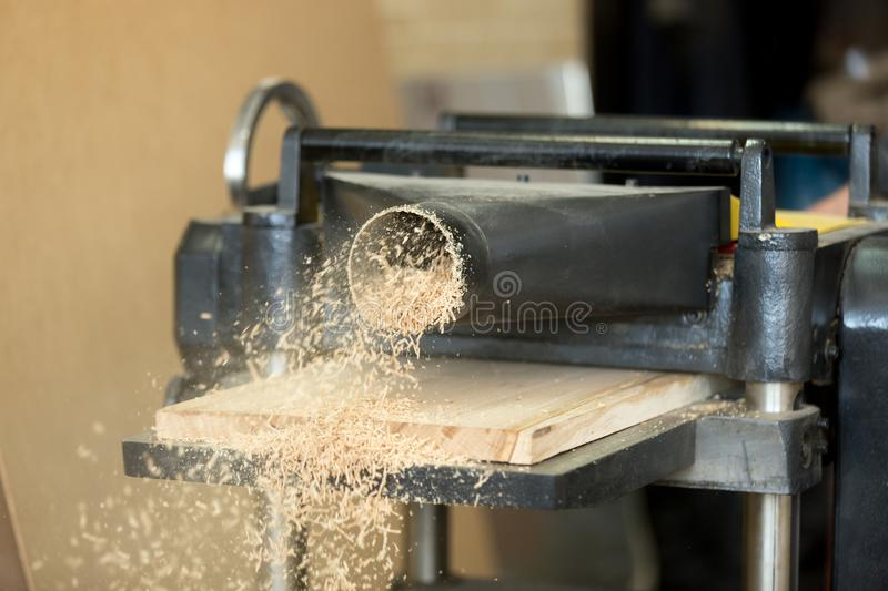 Stationary power woodworking planer processing wooden flooring b royalty free stock images