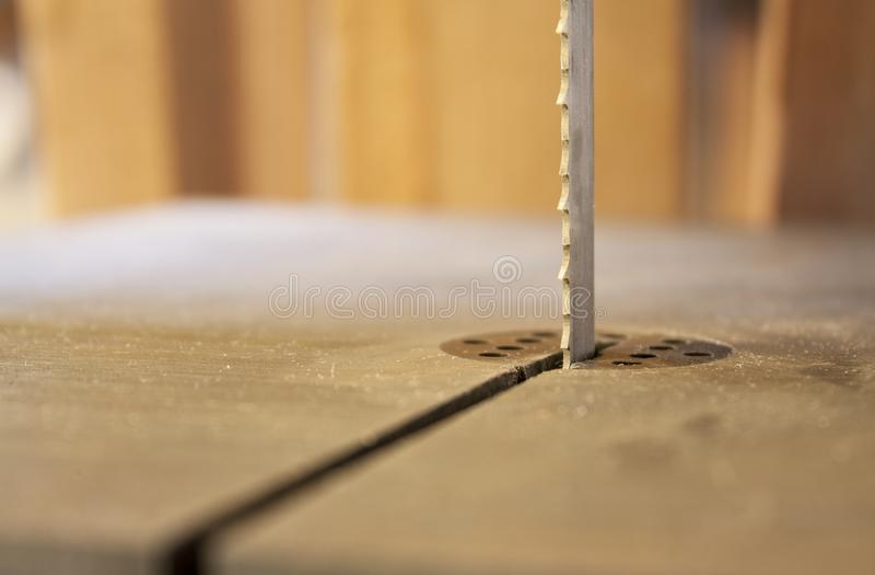 Woodworking machine Band saw. Machine cutting planks royalty free stock image