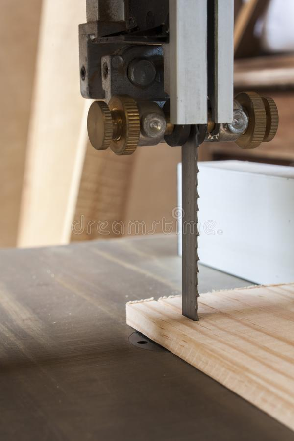 Woodworking machine Band saw. Machine cutting planks royalty free stock photography