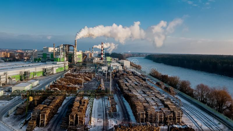 Woodworking plant. Wood processing industry.Factory for furniture production with pre-processed wood. aerial survey royalty free stock photo