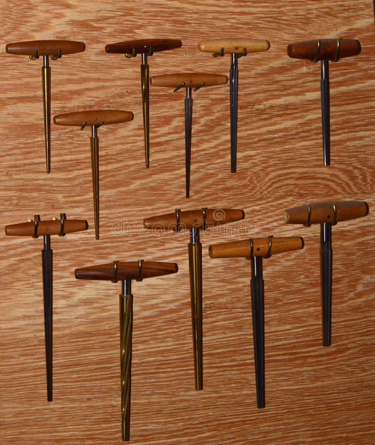 Woodworking tools 3. Array of fine woodworking tools on wall rack in violin repair shop stock photography