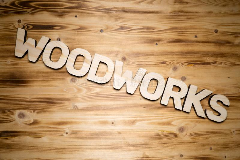 Woodworks word made of wooden block letters on wooden board royalty free stock images