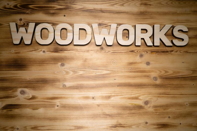 WOODWORKS word made of wooden letters on wooden board royalty free stock image