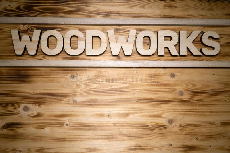 WOODWORKS word made of wooden letters on wooden board stock photography