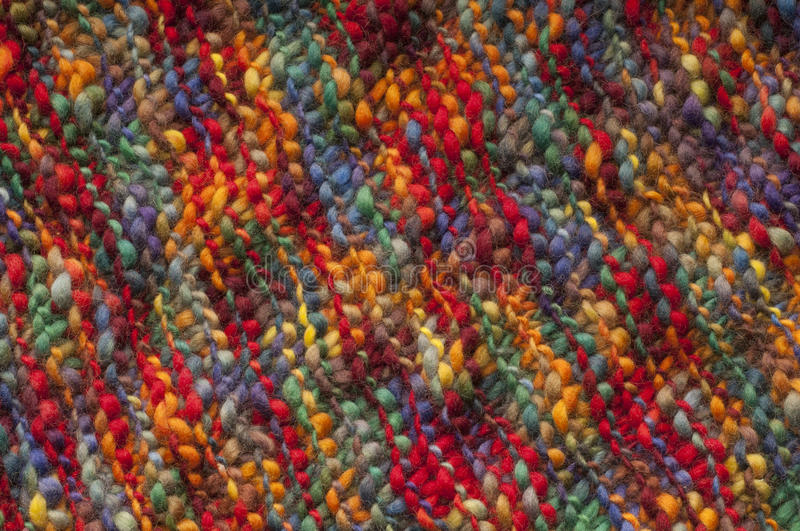 Wool. Natural wool fabric with colorful hand made stock photography