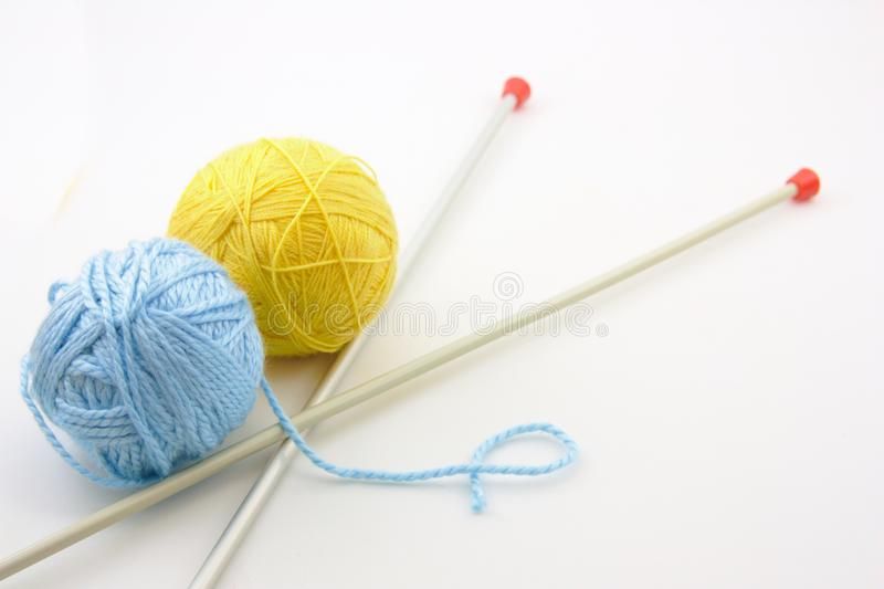 Wool clews and knitting needles on a neutral background stock photos