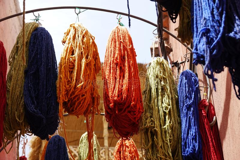 Wool colors details, shop in Morocco, in the desert, in Africa stock photos