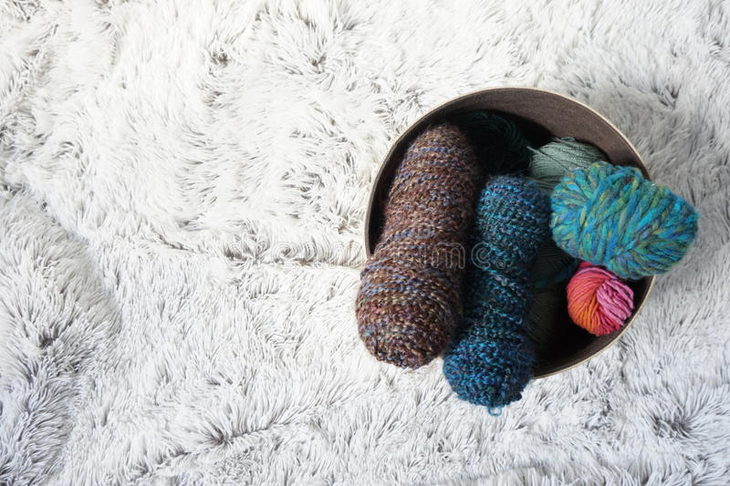Wool on cozy carpet royalty free stock images