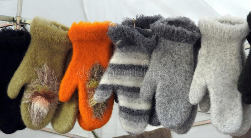 Wool gloves for sale stock photography