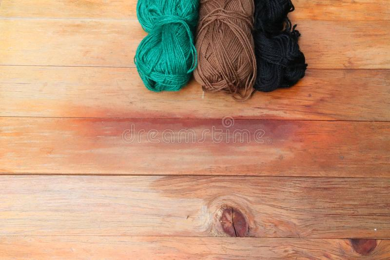 Wool on a red wooden table royalty free stock photo