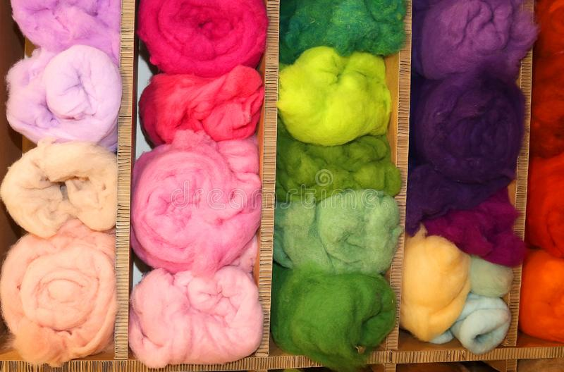 Wool for sale in balls in the wholesaler`s shop. Soft wool for sale in balls in the wholesaler`s shop royalty free stock photos